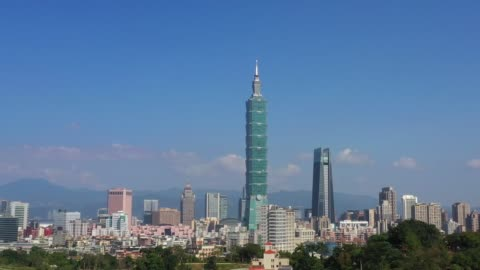 aerial drone shot of taipei during day time. taiwan city scape for tourist attraction and travel - taipei stock videos & royalty-free footage