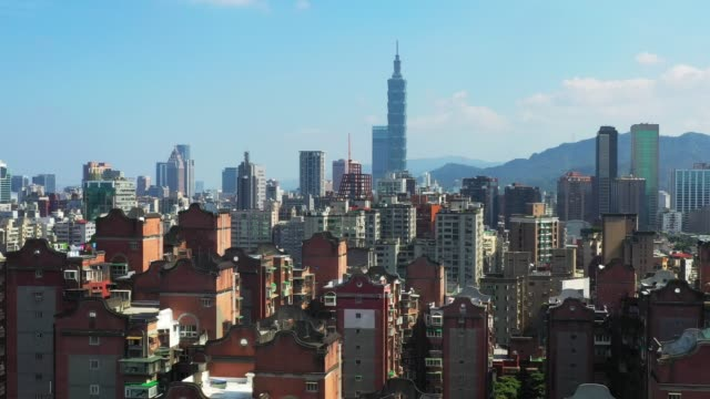 aerial drone shot of taipei during day time. taiwan city scape for tourist attraction and travel - taipei 101 stock videos & royalty-free footage