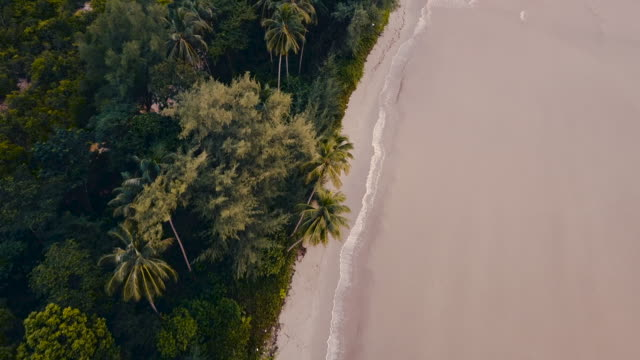 aerial drone shot of the coast and sea at sunset. - trat province stock videos and b-roll footage