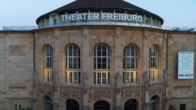 aerial drone shot of the freiburg theater house - zoom out stock videos & royalty-free footage