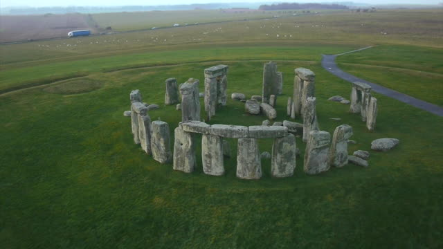 aerial drone shot of the standing stones of stonehenge. - paganism stock videos and b-roll footage