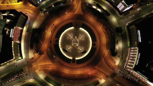 aerial drone shot of traffic at a roundabout in lisbon at night - roundabout stock videos & royalty-free footage