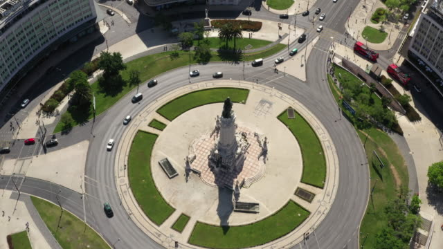 aerial drone shot of traffic at a roundabout in lisbon - roundabout stock videos & royalty-free footage