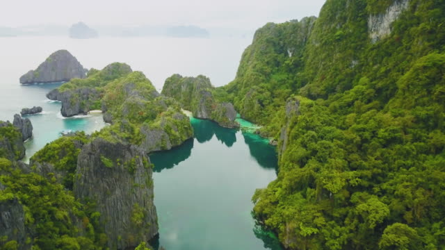 aerial drone shot of tropical island with rocks, palawan, philippines - filippine video stock e b–roll