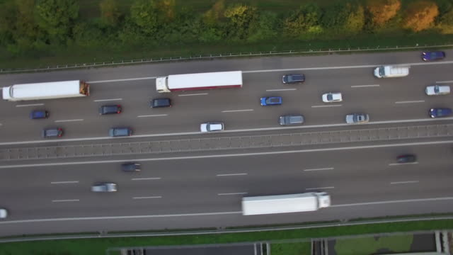 aerial drone shot of vehicles on autobahn 81 amidst patchwork landscape - patchwork landscape stock videos and b-roll footage