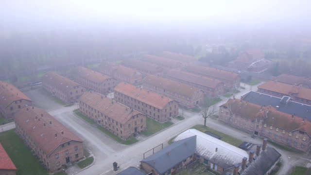 aerial drone shot over the auschwitz-birkenau concentration camp. - konzentrationslager stock-videos und b-roll-filmmaterial
