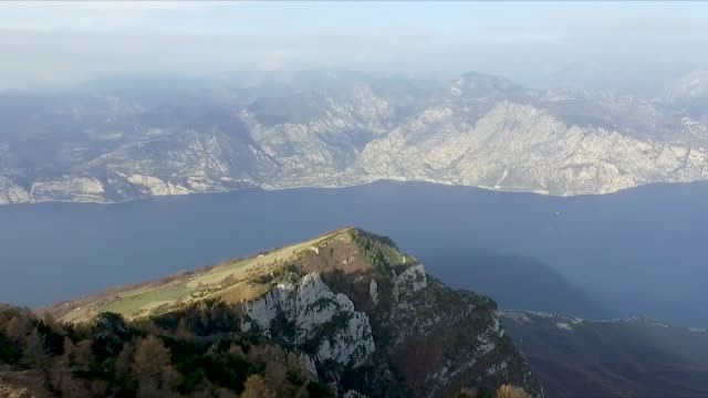 aerial drone shot revealing lake garda - lago video stock e b–roll