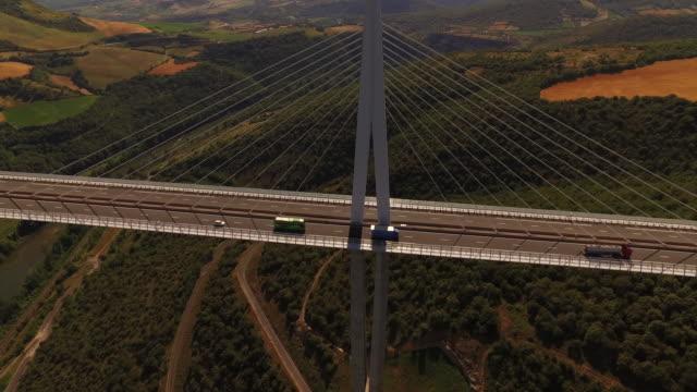 "vidéos et rushes de aerial drone shot traffic passing over millau viaduct, france - ""bbc universal"""