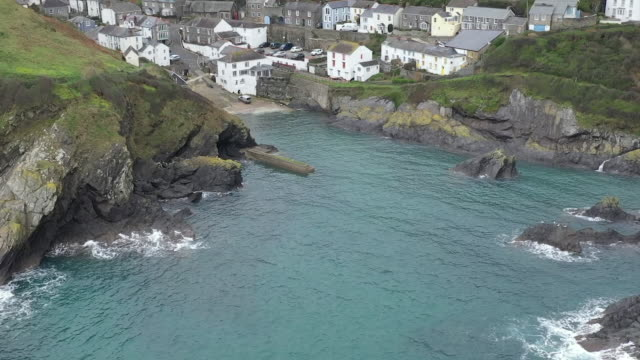 aerial drone shots of cornish coastline and port isaac on 11 february 2019 in cornwall united kingdom. - town stock videos & royalty-free footage