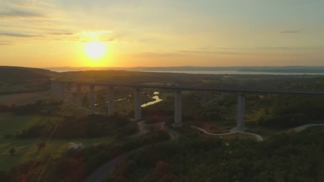 aerial drone sunset view of the m7 motorway highway viaduct bridge near koroshegy, hungary. - hungary stock videos & royalty-free footage