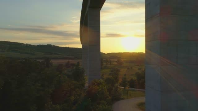 aerial drone sunset view of the m7 motorway highway viaduct bridge near koroshegy, hungary. - viaduct stock videos & royalty-free footage