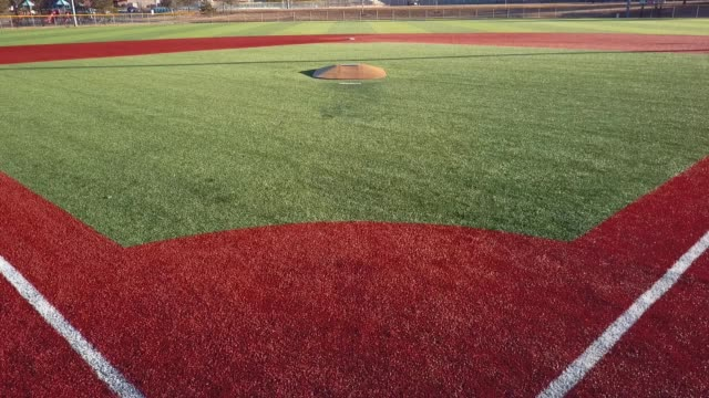 stockvideo's en b-roll-footage met castle rock, colorado/usa - march 28 2019: aerial drone video in the early morning of a freshly prepared local park baseball field ready for baseball opening day play. - honkbal teamsport