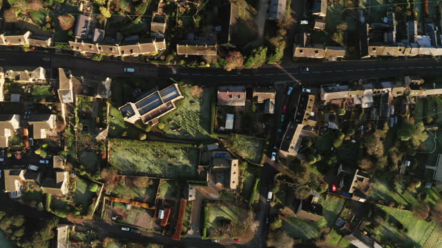 aerial drone video of a cotswolds village, a rural scene in english countryside with houses, property and real estate in the uk housing market, top down vertical shot of bourton on the hill, gloucestershire, england - video stock videos & royalty-free footage
