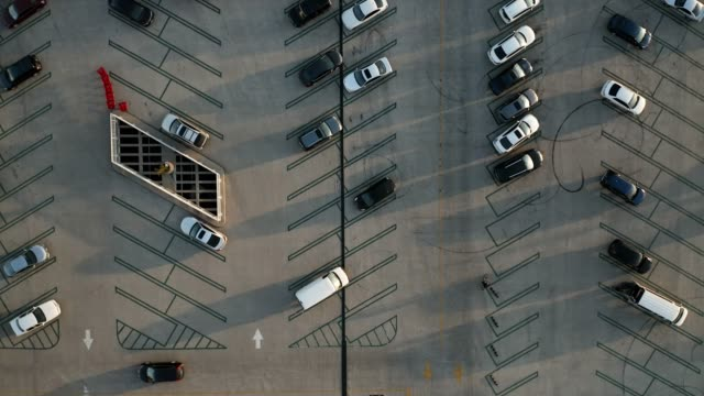 aerial drone video of a parking lot - parking stock videos & royalty-free footage