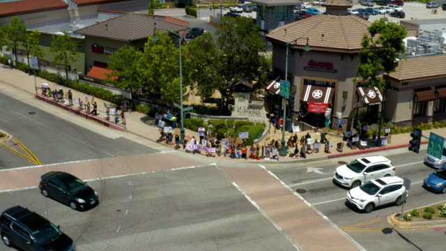 aerial drone video of black lives matter demonstration in los angeles suburb of canada. - small town america stock videos & royalty-free footage