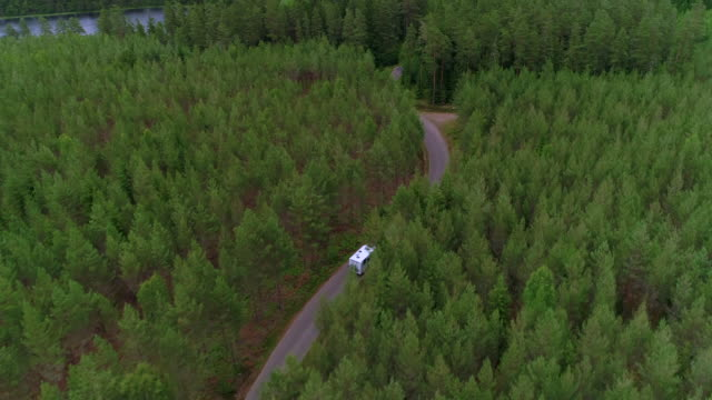 vidéos et rushes de aerial: drone video of camper van traveling in forest, - smaland, sweden - camping car