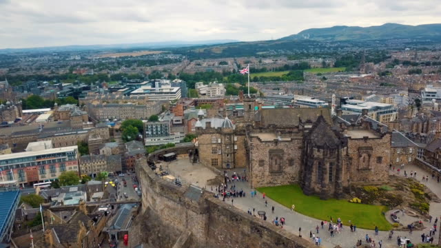 4K aerial drone video of castle, and ancient buildings in Edinburgh /Edinburgh Castle, Scotland