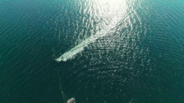 aerial drone video of kiteboarding at lazy point bay in napeague, suffolk county, long island, new york state, usa - kite sailing stock videos & royalty-free footage