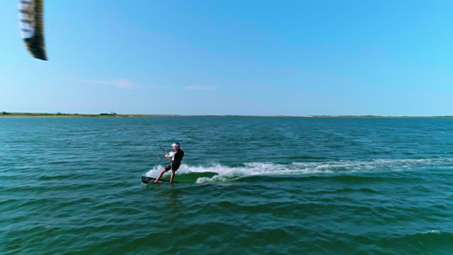 aerial drone video of kiteboarding at lazy point bay in napeague, suffolk county, long island, new york state, usa - eastern usa stock videos & royalty-free footage