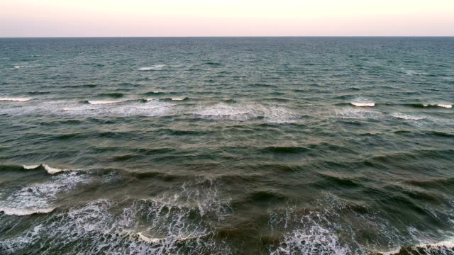 aerial drone view above gulf of mexico going out across crashing waves on padre island - gulf of mexico stock videos & royalty-free footage