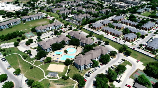 aerial drone view apartment complex aerial view above new development condo living - san marcos , texas , usa - complexity stock videos & royalty-free footage