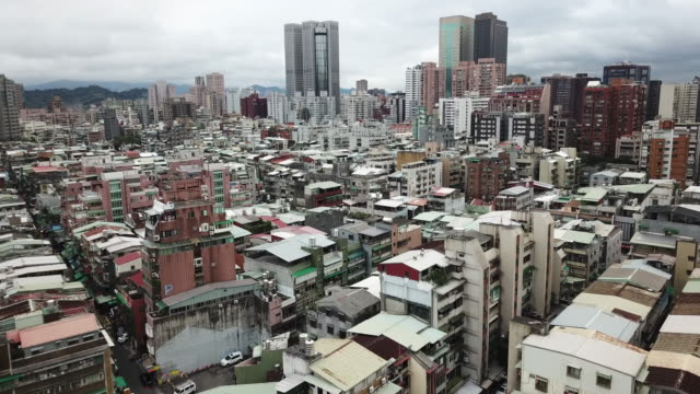 aerial drone view around xinyi road in taipei city. - cityscape stock videos & royalty-free footage