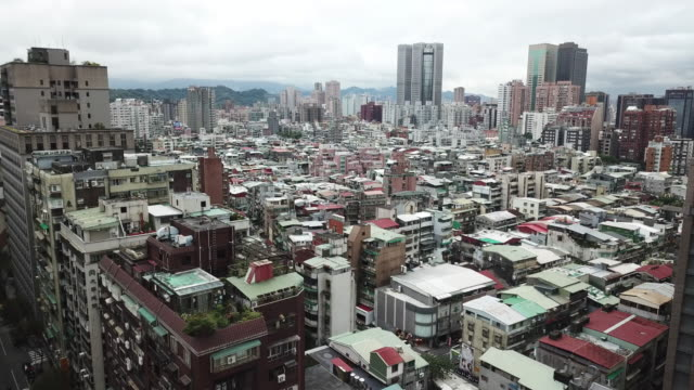 aerial drone view around xinyi road in taipei city - taipei stock videos & royalty-free footage