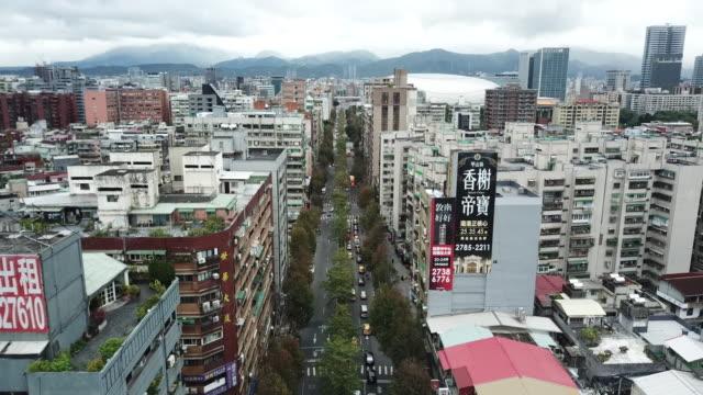 aerial drone view around xinyi road in taipei city. - taipei stock videos & royalty-free footage
