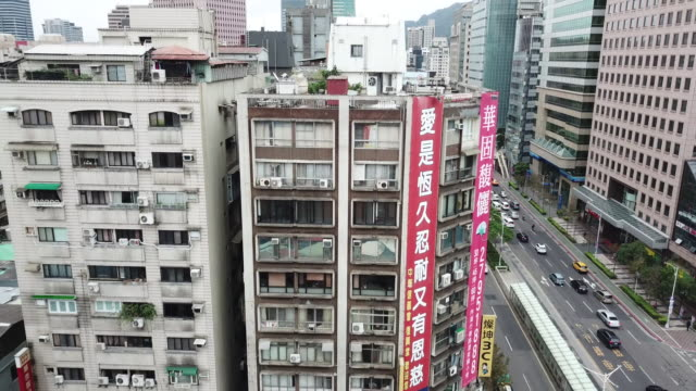 aerial drone view around xinyi road in taipei city - taipei 101 stock videos & royalty-free footage