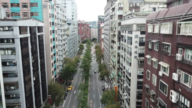 aerial drone view around xinyi road in taipei city. - taipei stock videos & royalty-free footage