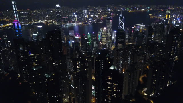 aerial drone view at night from victoria peak in hong kong - victoria peak stock videos & royalty-free footage