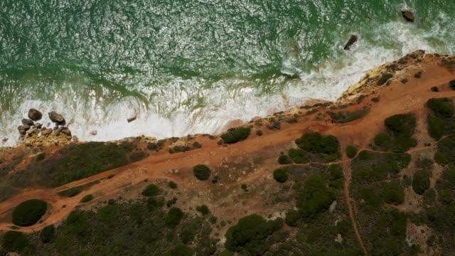 vídeos de stock e filmes b-roll de aerial drone view cliffs, beaches and atlantic ocean - geologia and rocha