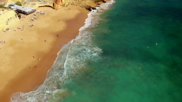 aerial drone view cliffs, beaches and atlantic ocean - algarve stock videos & royalty-free footage