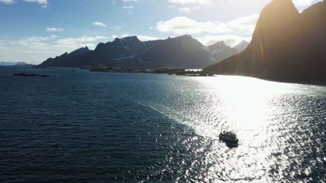 aerial drone view: fishing boat at lofoten islands in norway - trawler stock videos & royalty-free footage