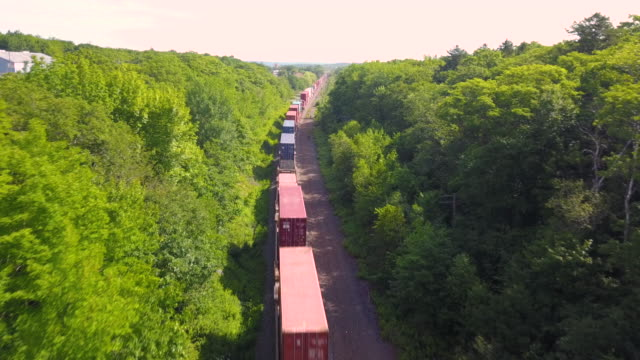 aerial drone view: freight train - rail transportation stock videos & royalty-free footage