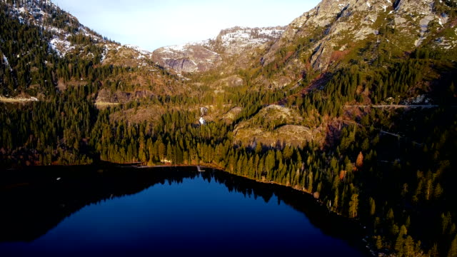 aerial drone view looking across amazing sierra nevada mountains at emerald bay sunrise in lake tahoe california - nevada stock videos & royalty-free footage