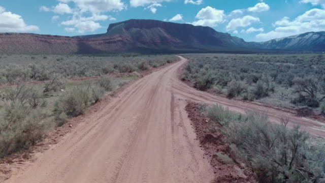aerial drone view of a 4x4 off-road dirt road near moab, utah. - goodsportvideo stock videos and b-roll footage