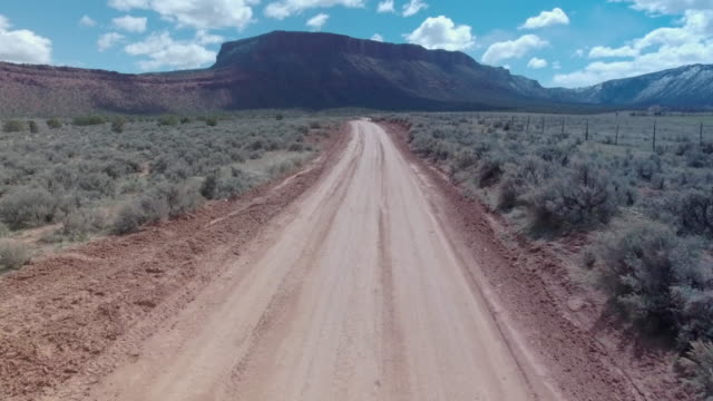 aerial drone view of a 4x4 off-road dirt road near moab, utah. - country road stock videos & royalty-free footage