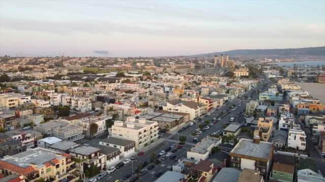 aerial drone view of a beach residential neighborhood district houses at sunset. - slow motion - desire stock videos & royalty-free footage