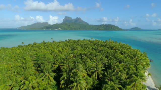 aerial drone view of a deserted island near bora bora tropical island. - pacific islands stock videos & royalty-free footage