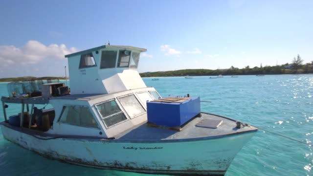 Aerial drone view of a fishing motor boat in the Bahamas, Caribbean.