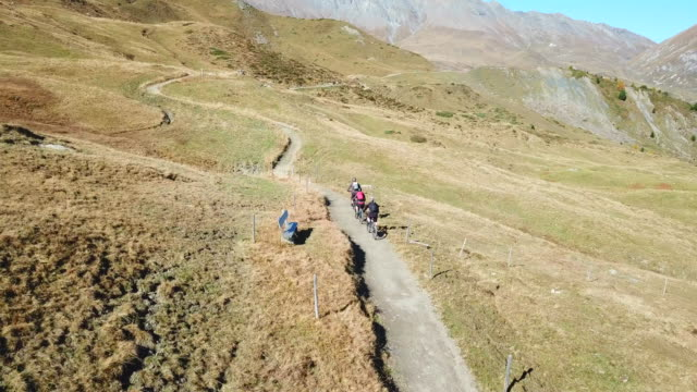 Aerial drone view of a group of mountain bikers on a singletrack trail.