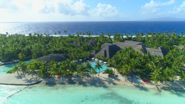 stockvideo's en b-roll-footage met aerial drone view of a luxury resort and pool in bora bora tropical island. - frans polynesië