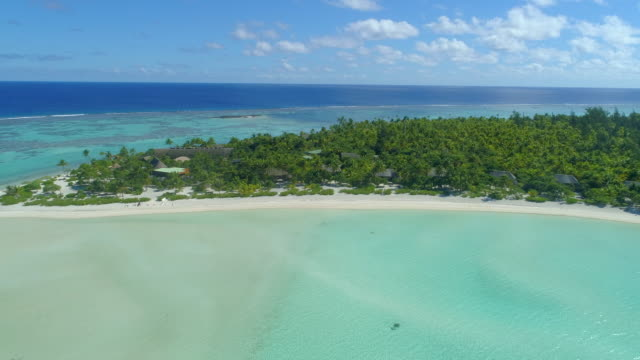 aerial drone view of a luxury resort hotel on a scenic tropical island in french polynesia. - south pacific ocean stock videos & royalty-free footage