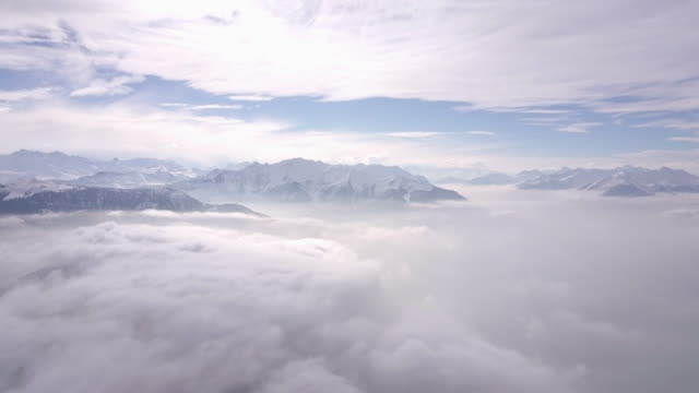 Aerial drone view of a scenic snowy mountain landscape.