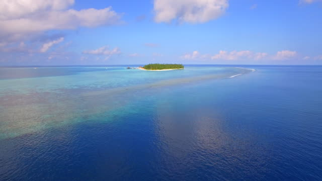 aerial drone view of a scenic tropical island in the maldives. - island stock videos and b-roll footage
