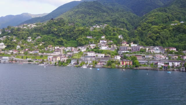 aerial drone view of a town village on lake maggiore, switzerland. - ticino canton stock videos and b-roll footage