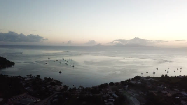 aerial drone view of after sunset over the bay of fare, on the lagoon of the island of huahine - fare video stock e b–roll