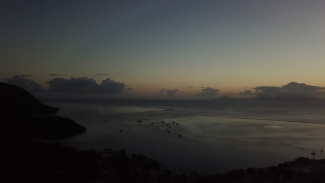 aerial drone view of after sunset over the bay of fare, on the lagoon of the island of huahine - huahine island stock videos and b-roll footage