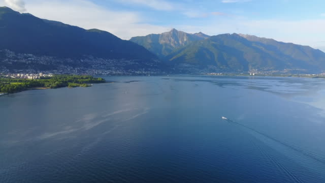 aerial drone view of boat boating on lake maggiore, switzerland. - motorboat stock videos & royalty-free footage
